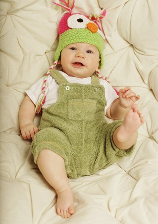 new baby: Portrait of cute happy 5 month old baby boy with funny hat. Photo of funny babe. Stock Photo