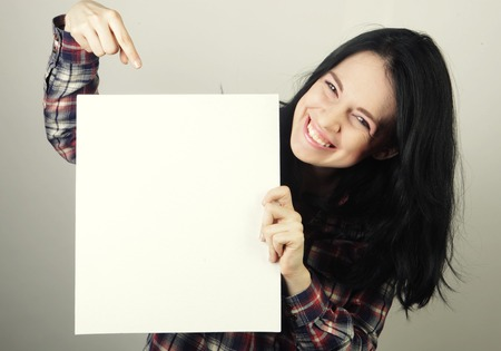 young casual woman happy holding blank sign 版權商用圖片