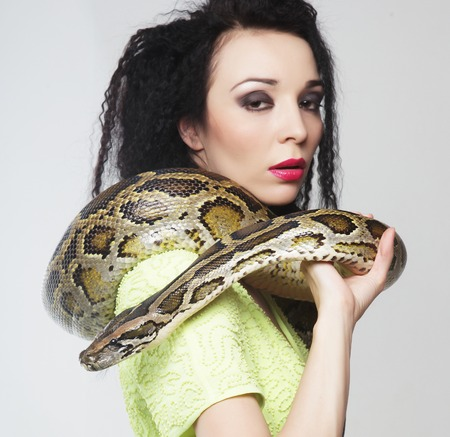 sexy black girl: beautiful woman with a snake Stock Photo