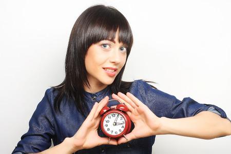 alarmclock: Young fun woman with alarmclock