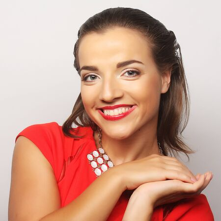 close up portrait young happy woman in red dress photo
