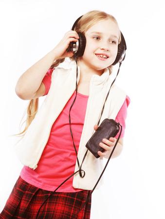girl headphones: dancing little blond girl headphones music singing on white background