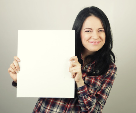 young casual woman happy holding blank sign Stock Photo