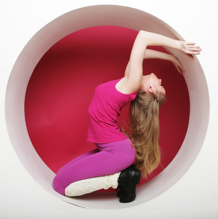 pink posing: Sporty young woman posing in pink circle