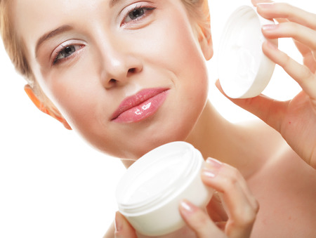 face and shoulders: Beautiful spa girl holding jar of cream