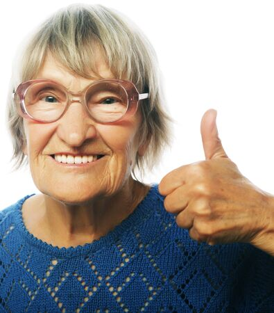 70 80 years: Old happy woman showing ok sign on a white background