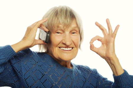 lady on phone: Smiling old lady communicating through mobile phone