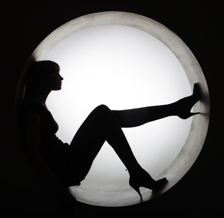 stylish black silhouette beautiful woman in circle Banque d'images