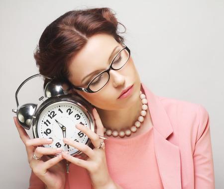 alarmclock: Young fun businesswoman with alarmclock