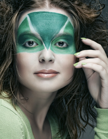 woman with green creative make-up photo
