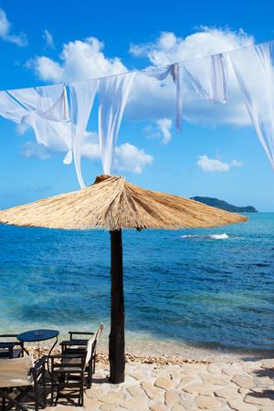 cameo: outdoor cafe bar table at Cameo beach, Zakynthos (Greece)