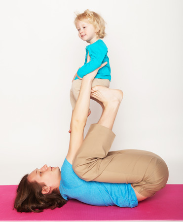 father holding his little son on his feet, yoga, happy family photo
