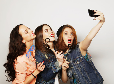 entertainment funny: funny girls, ready for party, selfie Stock Photo