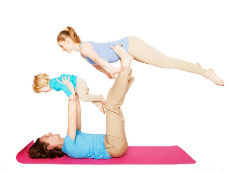 mother, father and son doing yoga over white background photo