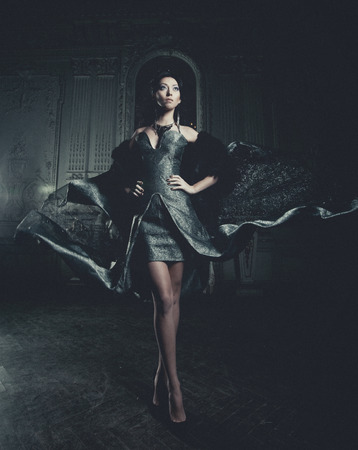 elegance: young elegance woman with flying dress in palace room