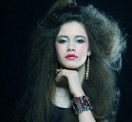 aucasian: High fashion model in black dress, with creative hairstyling on black background