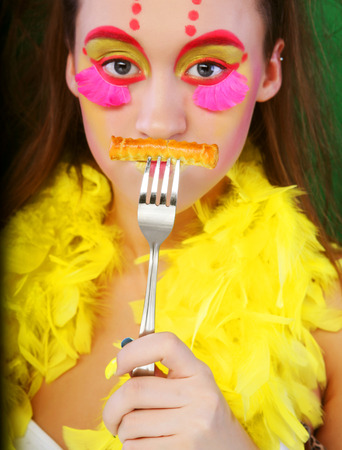 puckering lips: funny girl with crazy make-up