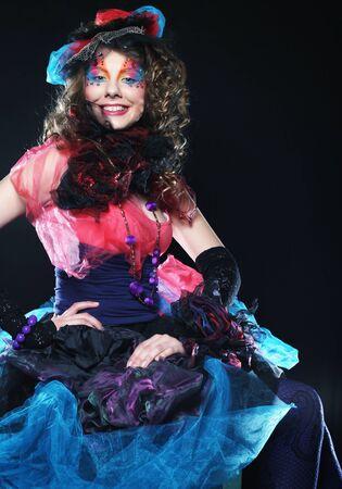 Fashion shot of woman in doll style. Creative make-up.Fantasy dress. Studio shot. photo