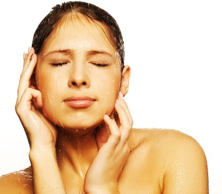 female in douche: Close-up of beautiful wet woman face with water drop. On white backgroundrr