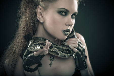 snake eyes: beautiful woman with a snake Stock Photo