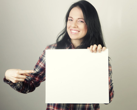 young casual woman happy holding blank sign Banque d'images