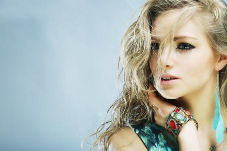 pose sensual: Portrait of young sensual blond woman. Studio shot. Stock Photo