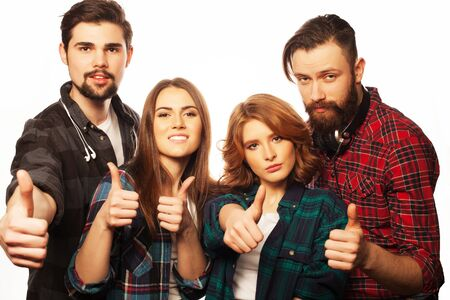 Life style, happiness and people concept: attractive group of happy young men and women. Hipster style. Studio shot over white . Special Fashionable toning. photo
