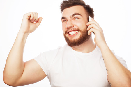 tehnology: life style, tehnology  and people concept:  cheerful man on the phone with fist raised receiving good news.