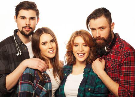 group of youg happy students isolated on white background photo