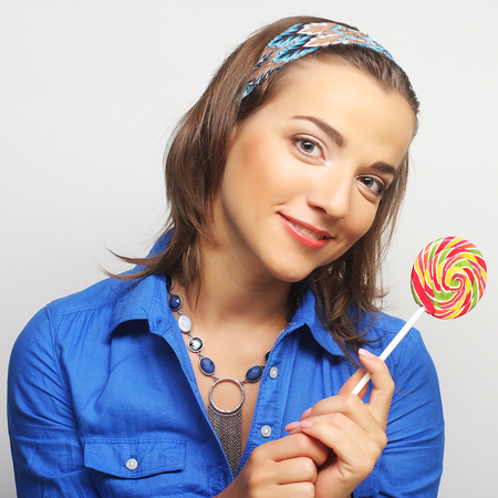 Nice young girl with lolipop photo