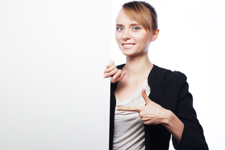 show business: Happy smiling young business woman showing blank signboard, over white  background