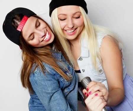 two young hipster girls singing photo