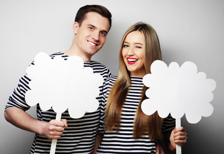 amorous: couple, love and family concept: amorous couple holding blank paper on stick. r