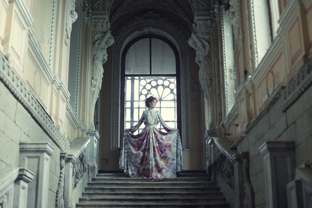 victorian girl: Beautiful woman standing on the top of a stairway