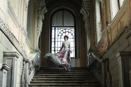 ttractive: Beautiful woman standing on the top of a stairway