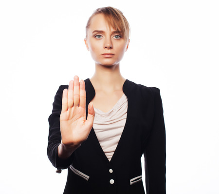 disclaim: Business, finance and people concept: young business woman making stop desture. Isolated on white background.