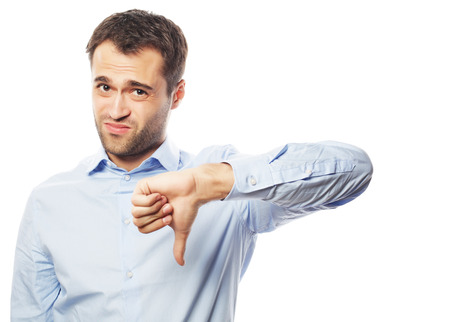 disapproval: business, success and people concept - Disappointed young business man with thumb down.