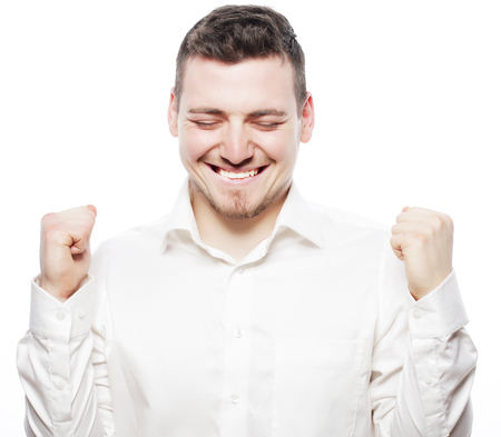 formalwear: life style, business  and people concept: successful businessman. Happy young man in formalwear gesturing and smiling while standing against white background Stock Photo