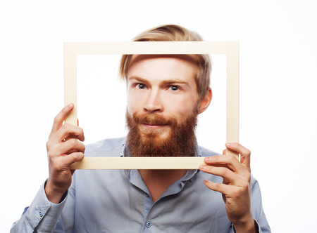 Funny Bearded Man With Golden Frame On Gray Background