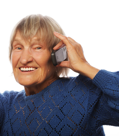 lady on phone: Smiling old lady communicating through mobile phone and thumb up