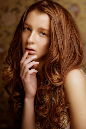 beautyful young woman with long curly hair photo