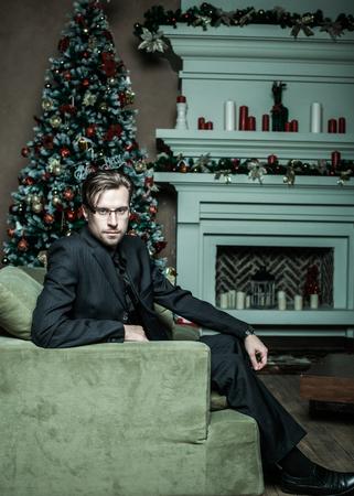 Fashion Man in luxury modern interior, Cristmass time. photo