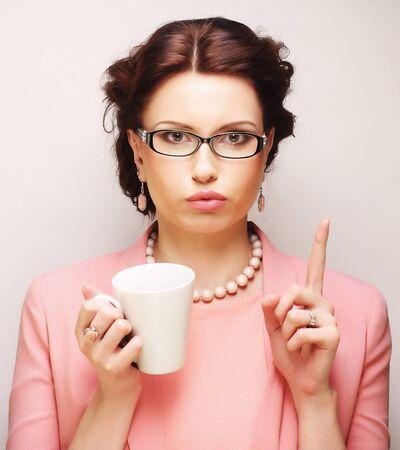 coffeebreak: Young businesswoman having a coffee-break Stock Photo