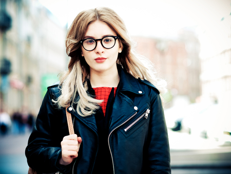 fashion hipster portrait of young beautiful blonde woman posing outdoor in summer Stock Photo
