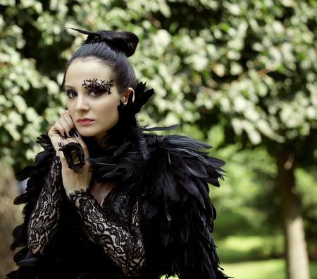 queen blue: Dark Queen in park. Fantasy black dress.