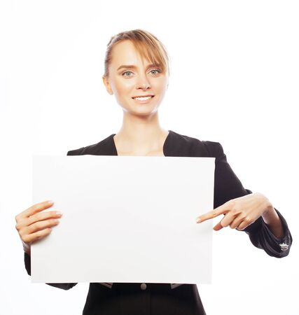signboard: Business, finance and people concept: happy smiling young business woman showing blank signboard, over white background Stock Photo