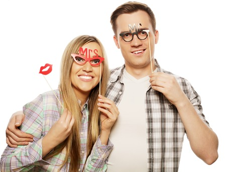 flirtation: people, friendship, love and leisure concept - lovely couple holding party glasses on stick