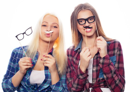 beautiful pictures: two stylish sexy hipster girls best friends ready for party, over white  background Stock Photo