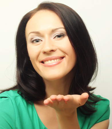 t short: young woman in green t-short with big happy smile