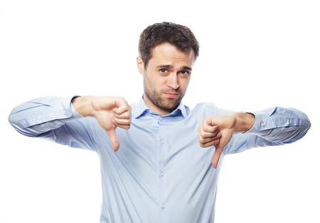 business, success and people concept - Disappointed young business man with thumb down.